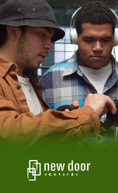 image of Daniel and other teen at New Door Ventures job-training internship program